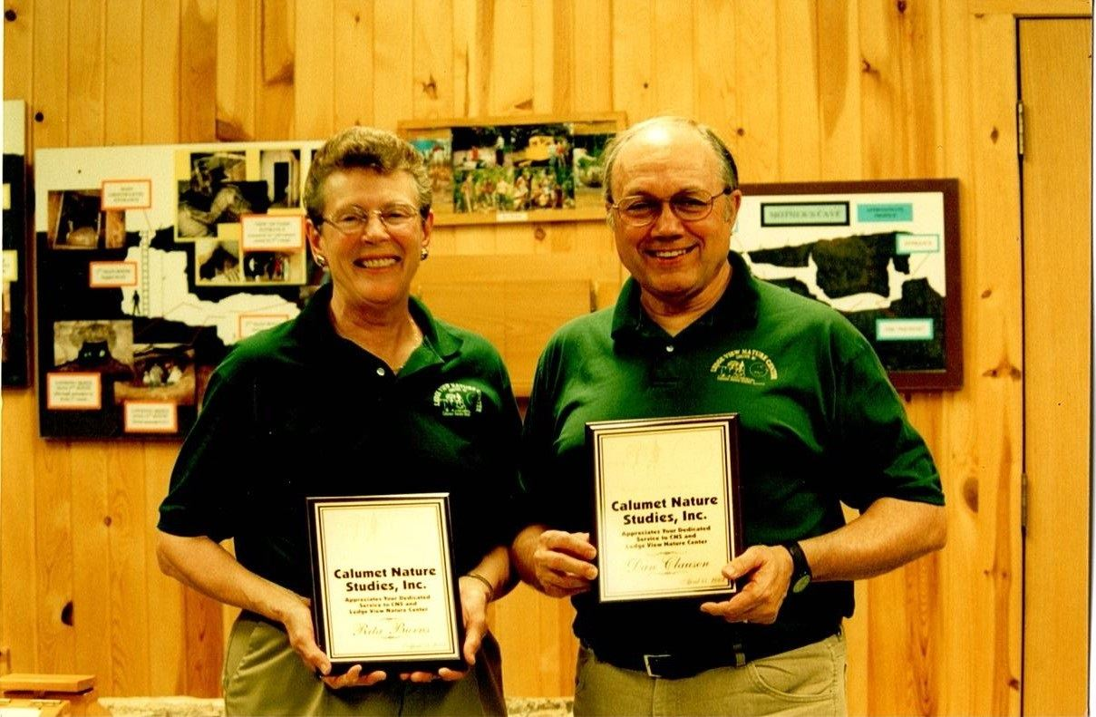 Rita Burns and Dan Clausen holding a Calumet Nature Studies Certificate