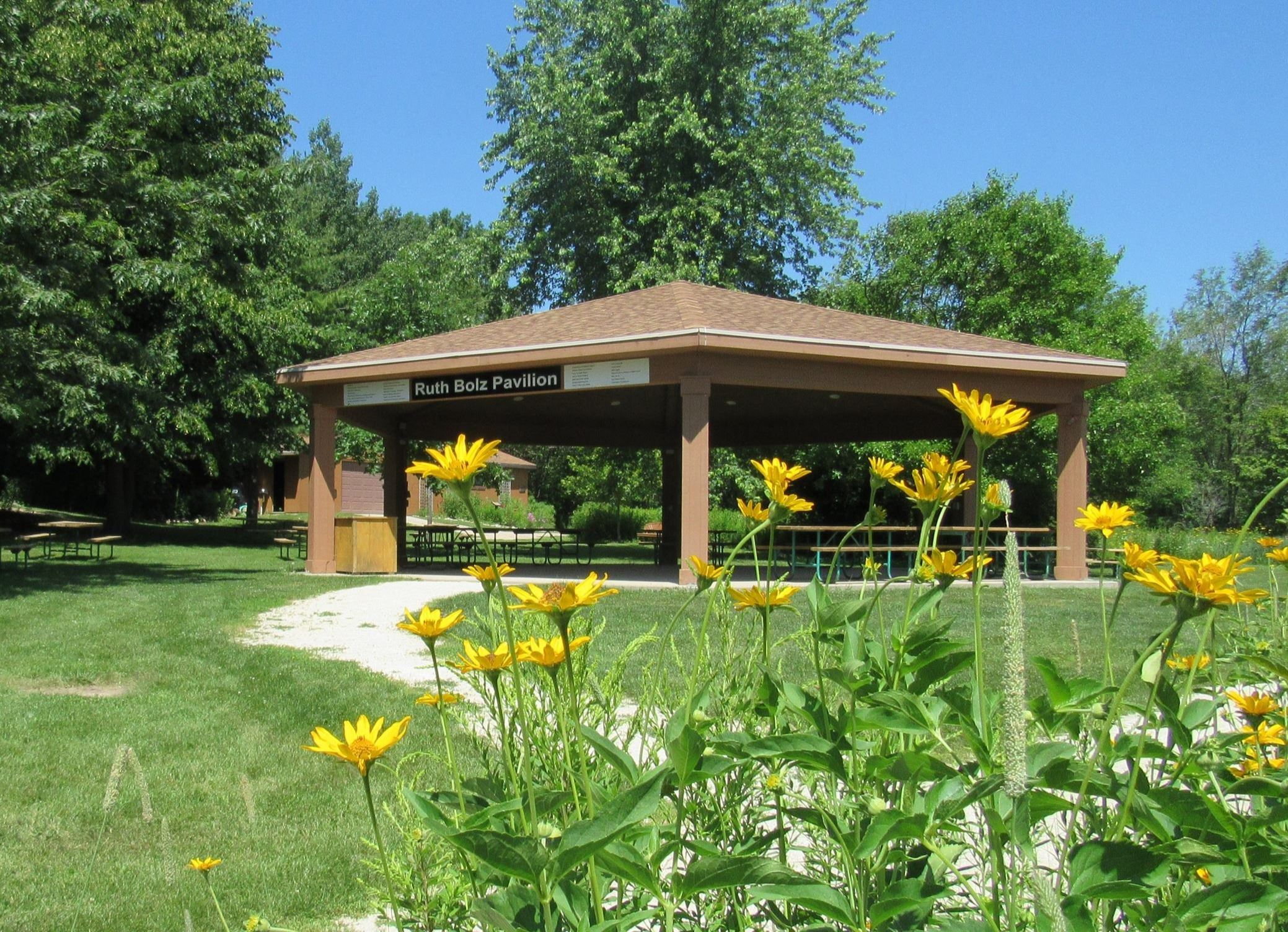 pavilion with prairie flowers near by