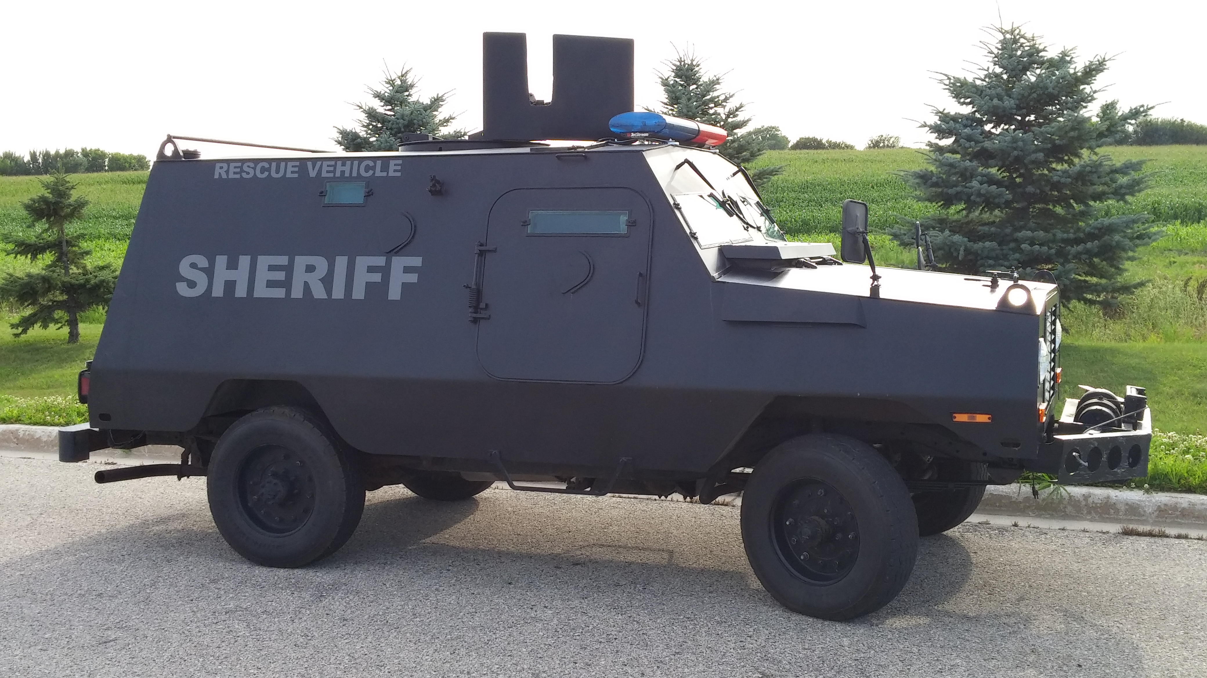 Sheriff SWAT vehicle parked on road